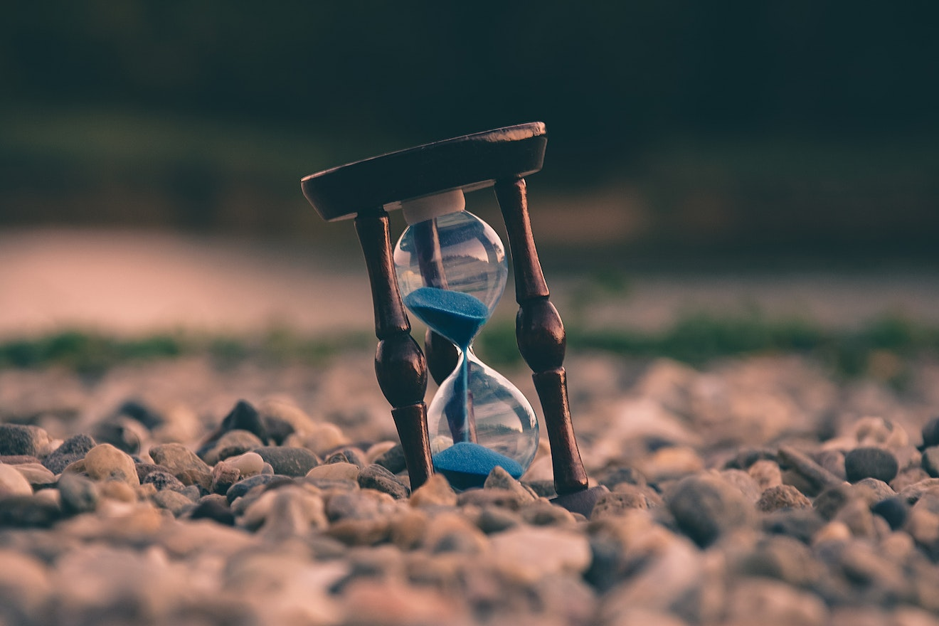 Hourglass on the ground, surrounded by stones
